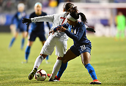February 27, 2019 - Chester, PA, U.S. - CHESTER, PA - FEBRUARY 27: US Forward Crystal Dunn (19) tackles Japan Midfielder Emi Nakajima (7) in the second half during the She Believes Cup game between Japan and the United States on February 27, 2019 at Talen Energy Stadium in Chester, PA. (Photo by Kyle Ross/Icon Sportswire) (Credit Image: © Kyle Ross/Icon SMI via ZUMA Press)