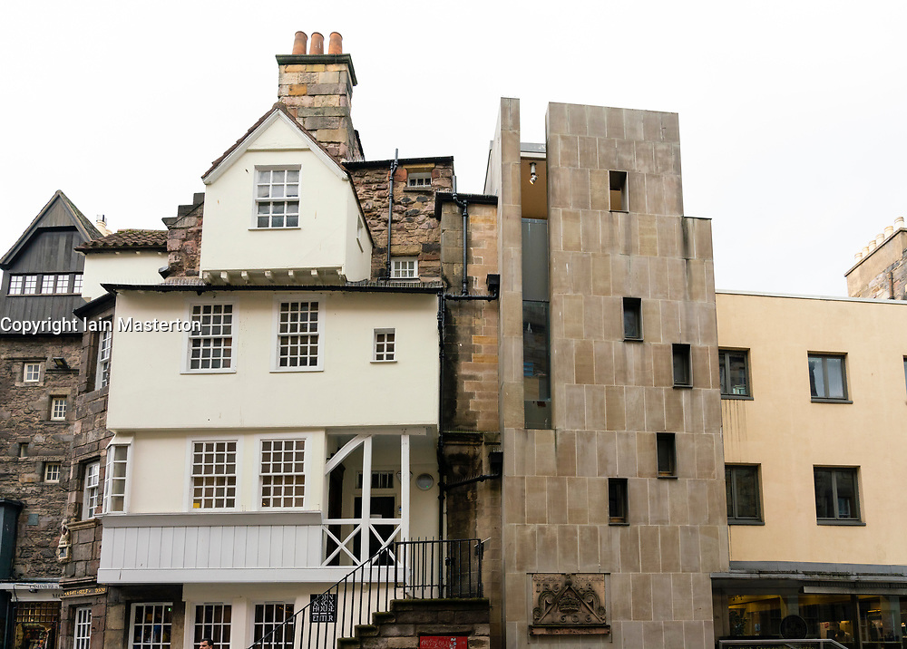 Contrasting old and modern architecture with John Knox House on left and Scottish Storytelling centre on right on Royal Mile ( High Street) in Edinburgh Old Town, Scotland, UK
