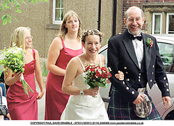 Escorted by a piper in full Scottish dress, her brides maids and father,<br />bride to be Kate Rusby walks from her home in Cawthorn Barnsley to the local<br />Church where she married John McCuscker on Saturday Afternoon (11/8/01)