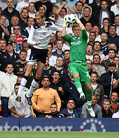 City keeper Joe Hart collects under pressure from Spurs Peter Crouch<br /> FA Barclays Premiership. Tottenham Hotspur v Manchester City. 14.08.10<br /> Photo By Karl Winter Fotosports International