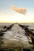 Editions of 17<br /> UK Pier at high tide with last light and wispy clouds catching suns color