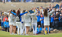 Team Europe wives and girlfriends celebrate during the Singles match on day three of the Ryder Cup at Le Golf National, Saint-Quentin-en-Yvelines, Paris.