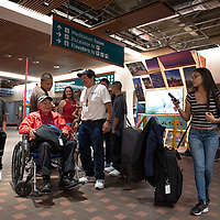 Lawrence Talamante, 94, with his family as they prepare to take him home at the Albuquerque International Sunport in Albuquerque Jun. 07.