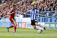 Sheffield Wednesday defender Daniel Pudil (36) takes on Cardiff City midfielder, Craig Noone (11) during the Sky Bet Championship match between Sheffield Wednesday and Cardiff City at Hillsborough, Sheffield, England on 30 April 2016. Photo by Phil Duncan.