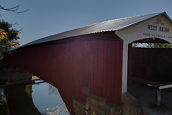 2015 Oct 19:   Parke County Indiana is the site of the Indiana Covered Bridge Festival every October.  This is the West Union.  It was built over Sugar Creek on Tow Path Road in 1876 and bypassed in 1964,  built by J.J. Daniels. The bridge has a 315' span.<br /> <br /> This image was produced in part utilizing High Dynamic Range (HDR) processes.  It should not be used editorially without being listed as an illustration or with a disclaimer.  It may or may not be an accurate representation of the scene as originally photographed and the finished image is the creation of the photographer.