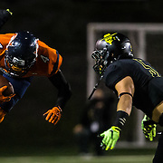 Darrel Watts (#4) of Orange Coast College gets tripped up by Phillip Hong of Golden West at Lebard College Stadium in Costa Mesa on November 7, 2015. <br /> <br /> (Photo by clint trahan/Sports Shooter Academy)