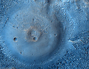 Possible Mud Volcanoes on Mars: Is this a mud volcano on Mars? If so, could it be dredging up Martian microbes? This strange possibility has been suggested recently and seems to fit several recent observations of Mars. First of all, hills like this seem to better resemble mud volcanoes on Earth than lava volcanoes and impact craters on Mars. Next, the pictured dome has an unusually textured surface consistent with fractured ice. Infrared images from space indicate that hills like this cool more quickly than surrounding rock, consistent with a dried mud composition. The hills also reflect colours consistent with a composition that formed in the presence of water. Finally, unusual plumes of gas containing methane have been found on Mars with unknown origin. These gas plumes could conceivably have been liberated by mud volcanoes, were the initially warm mud to contain methane-producing microbes drifting in a previously unobservable underground lake. A candidate mud volcano over 100 meters across is pictured above in the northern plains of Mars.