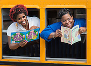 "Bus drivers pose for a photograph to promote the Houston ISD ""Reading and Riding"" program, April 7, 2015."