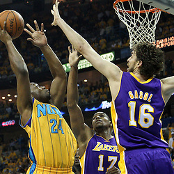 April 22, 2011; New Orleans, LA, USA; New Orleans Hornets power forward Carl Landry (24) shoots over Los Angeles Lakers power forward Pau Gasol (16) during the first quarter in game three of the first round of the 2011 NBA playoffs at the New Orleans Arena.    Mandatory Credit: Derick E. Hingle