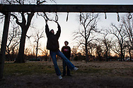 """Misty takes Khalil to Forest Park near their home in Parsons, Kansas. """"I pray to Allah that (Khalil) stays a Muslim, but there's a chance that he won't. And if he doesn't, it doesn't mean I'm going to love him any less, or anything else,"""" Abdul-Hakim said."""