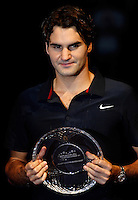 MADRID, SPAIN - OCTOBER 21: Roger Federer of Switzerland holds the runner up trophy after his ATP Masters Series tennis tournament final against David Nalbandian of Argentina on October 21, 2007 in Madrid, Spain. Federer lost the final match in three sets, 1-6, 6-3 and 6-3. (Photo by Manuel Queimadelos)