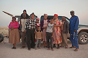 A Herero family poses in front of their car on a road near in Namibia, Africa.