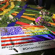 A sign is seen at a makeshift memorial during a vigil at the Dr. Phillips Center for the Performing Arts for the victims of a mass shooting at the Pulse nightclub Monday, June 13, 2016, in Orlando, Florida.  A gunman killed dozens of people in a massacre at the crowded gay nightclub in Orlando on Sunday, making it the deadliest mass shooting in modern U.S. history. (Alex Menendez via AP)