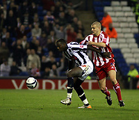 Photo: Mark Stephenson.<br /> West Bromwich Albion v Stoke City. Coca Cola Championship. 03/10/2007.West Brom's Ishmael Miller holds the ball up from Stoke's Carl  Dickinson