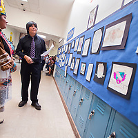 052413       Cable Hoover<br /> <br /> Zuni Middle School eighth-grader Chris Hughte explains some of the artwork to Miss Native UNM-G Amanda Martza, left, during the Zuni Middle School art show in Zuni Friday.