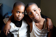 """Bothers Mohammed Kone,7, and Abraham,9 find comfort in the love they share with each other. The two go to school at a private Christian boarding school in Binghampton. The school allows students to live on campus, in order to be given the opportunity for a more successful educational experience. Fifteen years ago, """"God placed a burden on the heart """" of Mrs. Jo Walt, for the hurting children in our community. Her answer, was to open The Neighborhood School. They are originally from the Ivory Coast."""