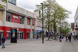 © Licensed to London News Pictures. 20/05/2021. London, UK. People wearing face masks walk along Hounslow High Street, West London. Hounslow is the first London borough to actively test for the Indian Covid variant B.1.617.2. Photo credit: Ray Tang/LNP