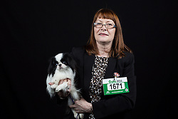 © Licensed to London News Pictures. 10/03/2016. Birmingham, UK. Carole Jackson with her Japanese Chin named Layah at Crufts 2016 held at the NEC in Birmingham, West Midlands, UK. The world's largest dog show, Crufts is this year celebrating it's 125th anniversary. The annual event is organised and hosted by the Kennel Club and has been running since 1891. Photo credit : Ian Hinchliffe/LNP