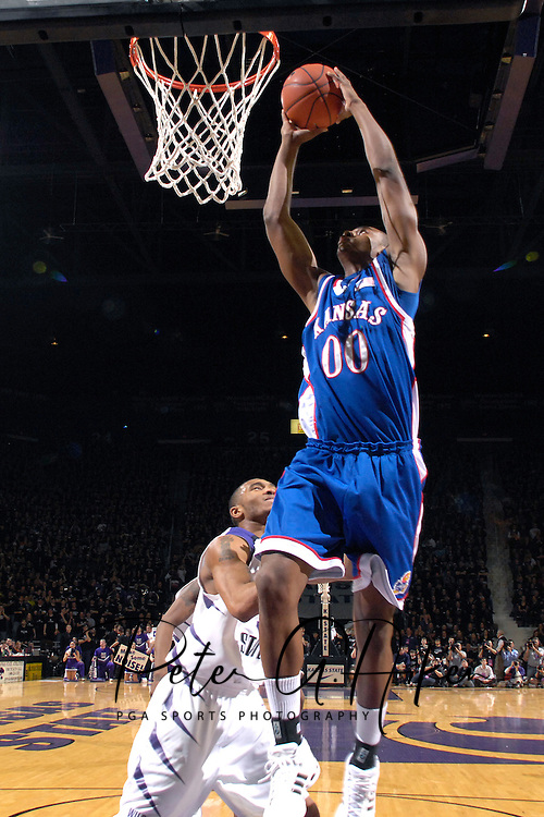 Kansas forward Darrell Arthur (00) drives over Kansas State guard Lance Harris (3) for the score in the first half at Bramlage Coliseum in Manhattan, Kansas, February 19, 2007.  K-State leads the Jayhawks at halftime 30-29.