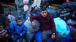 September 29, 2018 - Piraeus, Greece - Migrants seen sited on their luggages during their arrival at the port..400 migrants and refugees were transferred upon their arrival from the island of Lesbos, because the camp of Moria is full of refugees and migrants. (Credit Image: © Ioannis Alexopoulos/SOPA Images via ZUMA Wire)