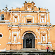 The burnt sienna colored Iglesia en San Pedro las Huertas, about 15 minutes away from Antigua, Guatemala.