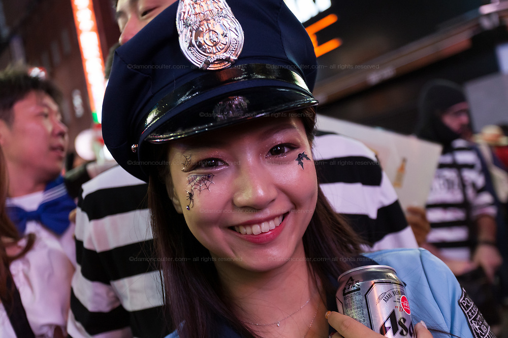 A Japanese woman dressed as a sexy police officer during the Halloween celebrations Shibuya, Tokyo, Japan. Saturday October 27th 2018. The celebrations marking this event have grown in popularity in Japan recently. Enjoyed mostly by young adults who like to dress up, drink , dance and misbehave in parts of Tokyo like Shibuya and Roppongi. There has been a push back from Japanese society and the police to try to limit the bad behaviour.