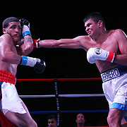 Josue Vargas of Puerto Rico (L) fights Carlos Winton Velasquez of Nicaragua during the Puerto Rico vs The World boxing event at Orlando Live Events Center on Friday, March 24, 2017 in Casselberry, Florida.  (Alex Menendez via AP)