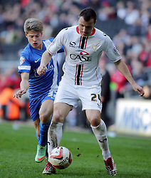 Milton Keynes Dons' Antony Kay in action with Peterborough United's Lloyd Isgrove - Photo mandatory by-line: Joe Dent/JMP - Mobile: 07966 386802 15/03/2014 - SPORT - FOOTBALL - Milton Keynes - Stadium MK - MK Dons v Peterborough United - Sky Bet League One