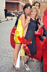 Left to right, ASSIA WEBSTER and KELLY HOPPEN at a treasure hunt and dinner hosted by Fiat to celebrate the launch of the Fiat 500 C held at Zuma, Raphael Street, London on 29th June 2009.