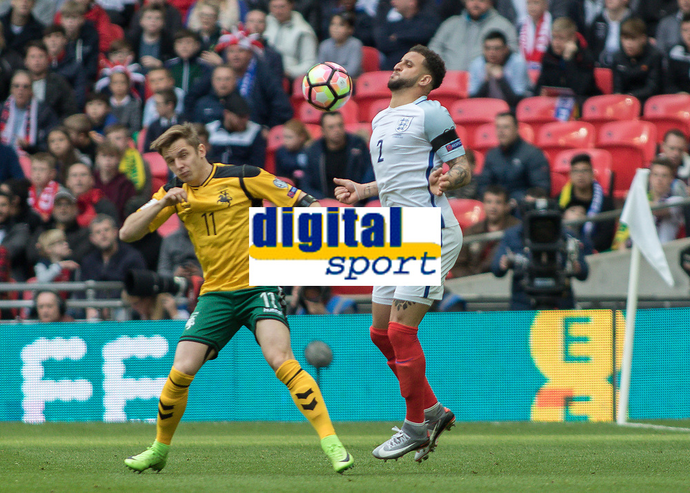 Football - 2016 / 2017 World Cup Qualifier - UEFA Group F: England vs. Lithuania<br /> <br /> Kyle walker of England brings the ball under control with his chest as Arvydas Novikovas of Lithuania protects himself at Wembley.<br /> <br /> COLORSPORT/DANIEL BEARHAM