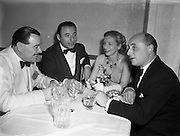 13/10/1952<br /> 10/13/1952<br /> 13 October 1952<br /> Variety Club of Ireland Dance at the Metropole Hotel, Dublin. Pictured are left -right:<br />  Jimmy Campbell of the Theatre Royal; Joe Loss, band leader;  Alice Delgarno and Louis Elliman, Manager of the Theatre Royal.