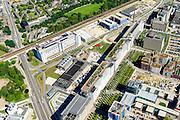 Nederland, Noord-Brabant, Eindhoven, 23-08-2016; stadsdeel Strijp. Strijp-S voormalig bedrijventerrein van Philips, was niet toegankelijk voor het publiek, 'de verboden stad'. Het gebied, wordt ontwikkeld voor wonen, werken en cultuur en kent  diverse Rijksmonumenten, onder andere  Philitefabriek met Klokgebouw, het Veemgebouw en de reeks gebouwen bekend als De Hoge (Witte) Rug.<br /> Strijp-S, former Philips area, was not accessible to the public, 'the forbidden city'. The area, with several national monuments, is designated for living, working and culture.<br /> luchtfoto (toeslag op standard tarieven);<br /> aerial photo (additional fee required);<br /> copyright foto/photo Siebe Swart
