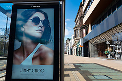 Edinburgh, Scotland, UK. 8 April 2020. Images from Edinburgh during the continuing Coronavirus lockdown. Pictured; Incongruous video screen advertising fashion brand on an empty Princes Street with all shops closed.  Iain Masterton/Alamy Live News.