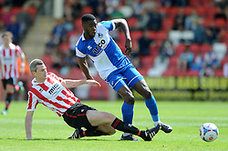 Nathan Blissett of Bristol Rovers is tackled by Arron Downes of Cheltenham Town - Mandatory by-line: Dougie Allward/JMP - 25/07/2015 - SPORT - FOOTBALL - Cheltenham Town,England - Whaddon Road - Cheltenham Town v Bristol Rovers - Pre-Season Friendly