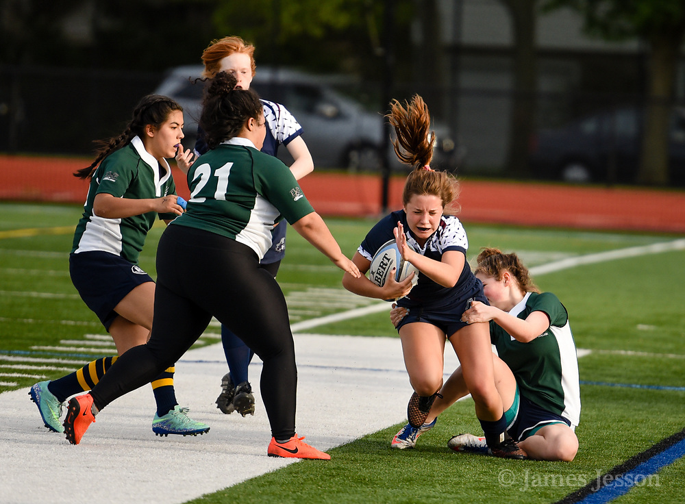 Belmont's Grace Curtis runs the ball during the game against the Needham High team at Harris Field in Belmont, May 23, 2017.   [Wicked Local Photo/James Jesson]
