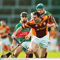 2 December 2007; Brian Quinn, Tulla, in action against Derek Bourke, Loughmore Castleiney. AIB Munster Club Hurling Championship Final, Loughmore-Castleiney, Tipperary v Tulla, Clare, Gaelic Grounds, Limerick. Picture credit; Brendan Moran / SPORTSFILE