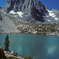 Temple Crag towers above Second Lake in Big Pine Canyon of California's Sierra Nevada.  North Palisade Peak is behind on the right.