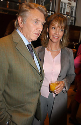 Photographer DON McCULLIN and SABRINA GUINNESS at a party to celebrate the publication of 'Last Voyage of The Valentina' by Santa Montefiore at Asprey, 169 New Bond Street, London W1 on 12th April 2005.<br />