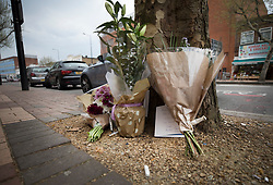 © Licensed to London News Pictures. 21/04/2018. London, UK. Floral tributes and cards are placed opposite Morden Underground, south London near where a man died following an assault. Police were called by the London Ambulance Service at 22:17hrs on Thursday, 19 April, after ambulance staff suspected that a man collapsed on London Road in Morden had been assaulted. The 32-year-old man was taken to a south London hospital in a critical condition. He died at 23:45hrs on Friday, 20 April. His next of kin have been informed. Photo credit: Peter Macdiarmid/LNP