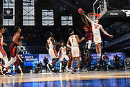 INDIANAPOLIS, IN - MARCH 19: Colin Castleton #12 of the Florida Gators blocks a shot by Tyrece Radford #23 of the Virginia Tech Hokies  in the first round of the 2021 NCAA Division I Men's Basketball Tournament held at Hinkle Fieldhouse on March 19, 2021 in Indianapolis, Indiana. (Photo by Brett Wilhelm/NCAA Photos via Getty Images)