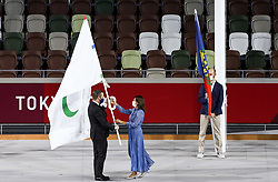 TOKYO, JAPAN - SEPTEMBER 05: Andrew Parsons, President of the International Paralympic Committee hands over the Paralympic flag to Anne Hidalgo, Mayor of Paris  during the Closing Ceremony of the Tokyo 2020 Paralympic Games at Olympic Stadium on September 5, 2021 in Tokyo, Japan. Photo by Vid Ponikvar / Sportida