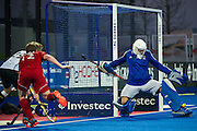 Great Britain's George Pinner cuts out a cross. Great Britain v Germany, Lee Valley Hockey & Tennis Centre, London, UK on 14 April 2015. Photo: Simon Parker