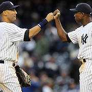 Derek Jeter, (left), New York Yankees, congratulates team mate Alfonso Soriano, after the Yankees win during the New York Yankees V Baltimore Orioles home opening day at Yankee Stadium, The Bronx, New York. 7th April 2014. Photo Tim Clayton