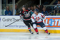 KELOWNA, CANADA - OCTOBER 16: Colton Heffley #25 of the Kelowna Rockets checks Griffin Foulk #2 of the Lethbridge Hurricanes on October 16, 2013 at Prospera Place in Kelowna, British Columbia, Canada.   (Photo by Marissa Baecker/Shoot the Breeze)  ***  Local Caption  ***