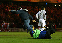 Photo: Jed Wee.<br /> Middlesbrough v FC Basle. UEFA Cup. Quarter-Final. 06/04/2006.<br /> <br /> A steward tackles a fan who charges onto the pitch after the winning goal.