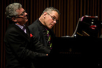"""Steven Blier, right, and Michael Barrett play the piano during the Juliard School's performance of """"A Modern Person's Guide To Hooking Up and Breaking Up"""" held at the Peter Jay Sharp Theater. 1/16/08. Photographer: Robert Caplin For The New York Times"""