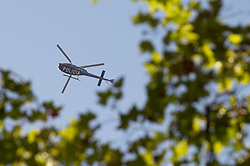 BARCELONA (SPAIN), Aug. 17, 2017  A police helicopter flies around Plaza Catalonia following a terrorist attack in central Barcelona, Spain, on Aug. 17, 2017. Thirteen people were killed, 80 others injured and hospitalized with 15 of them in serious condition in Barcelona terrorist attack on Thursday afternoon, Spanish official said. (Credit Image: © Lino De Vallier/Xinhua via ZUMA Wire)