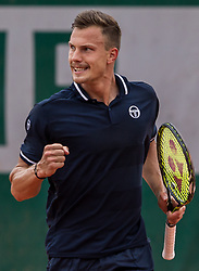 May 29, 2018 - Paris, France - Márton Fucsovics of Hungary aginst Vasek Pospisil of Canada during the first round at Roland Garros Grand Slam Tournament - Day 3 on May 29, 2018 in Paris, France. (Credit Image: © Robert Szaniszlo/NurPhoto via ZUMA Press)