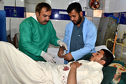 May 5, 2017 - Quetta, Pakistan - Pakistani paramedics give treatment to an injured man at a hospital following cross-border firing, in southwest Pakistan's Quetta. The Pakistan army said on Friday that border with Afghanistan in Chaman area has been closed after three Pakistanis were killed by ''unprovoked'' firing from the Afghan side, while 18 others were injured. (Credit Image: © Asad/Xinhua via ZUMA Wire)