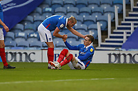 Football - 2020 / 2021 Sky Bet League One - Portsmouth vs. Crewe Alexandra - Fratton Park<br /> <br /> Portsmouth's Jack Whatmough congratulates and checks on the fitness of goalscorer Portsmouth's Ronan Curtis after Curtis injured himself scoring his and Pompeys second goal at Fratton Park <br /> <br /> COLORSPORT/SHAUN BOGGUST